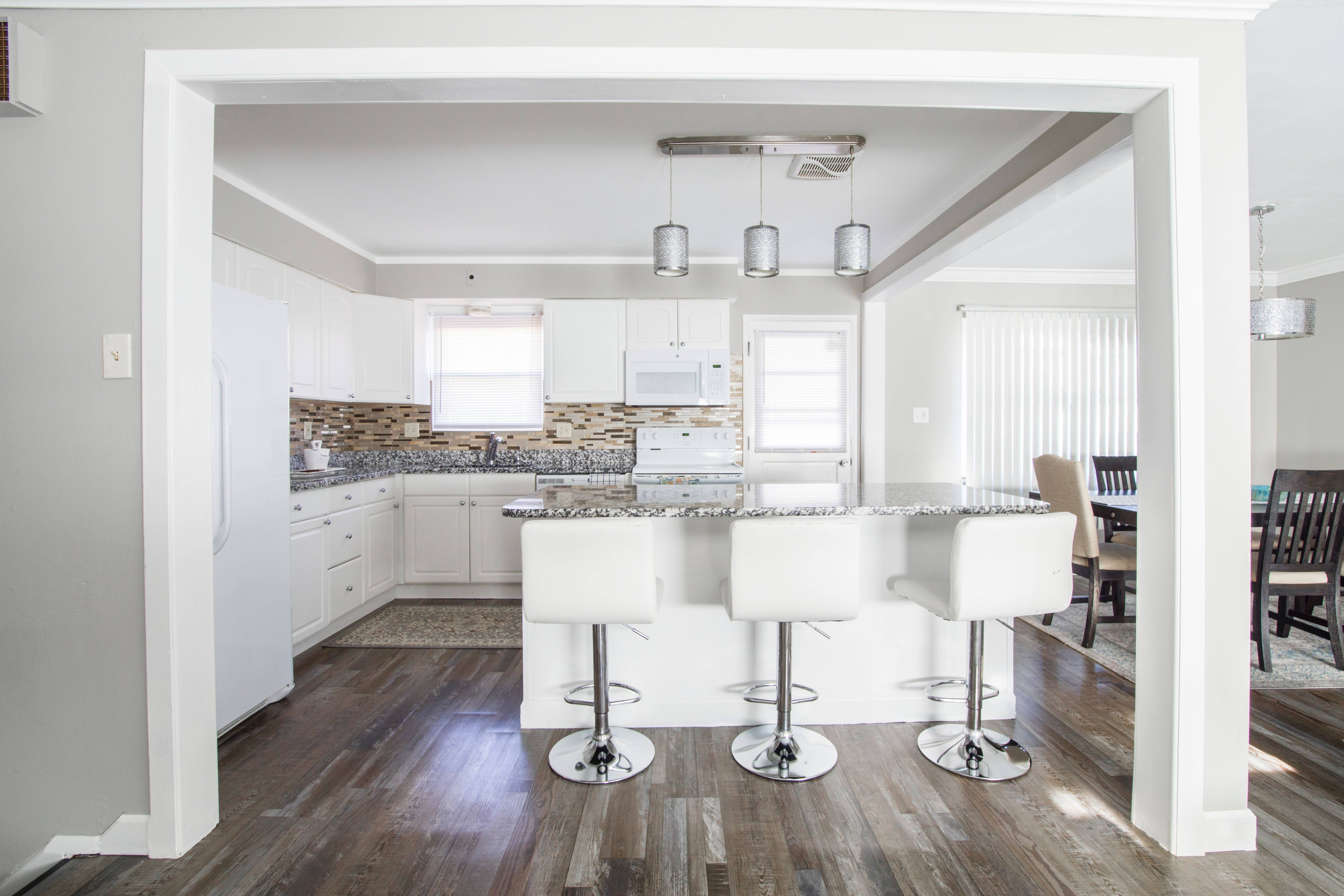 contemporary kitchen remodel with wood floors white cabinets large island